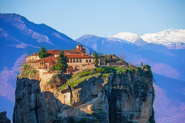 Mountain Monastery of the Holy Trinity View on the mysterious Monastery of the Holy Trinity, situated in the mountains of Greece monastery stock pictures, royalty-free photos & images