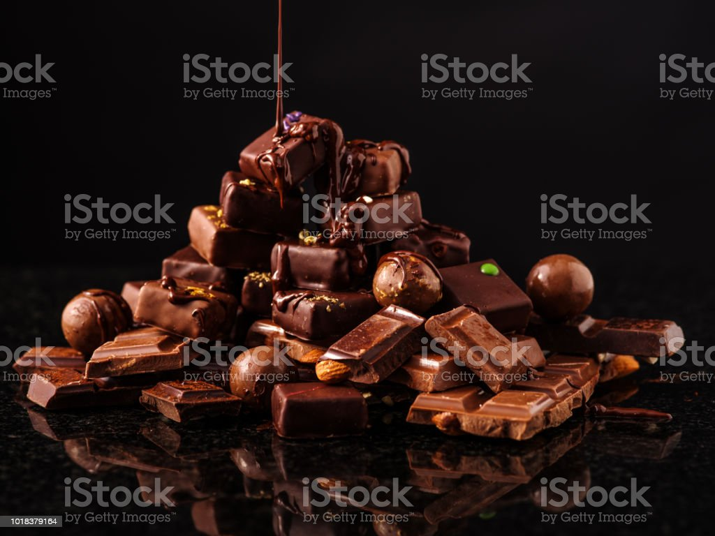 Mountain of chocolate and chocolates candys. стоковое фото
