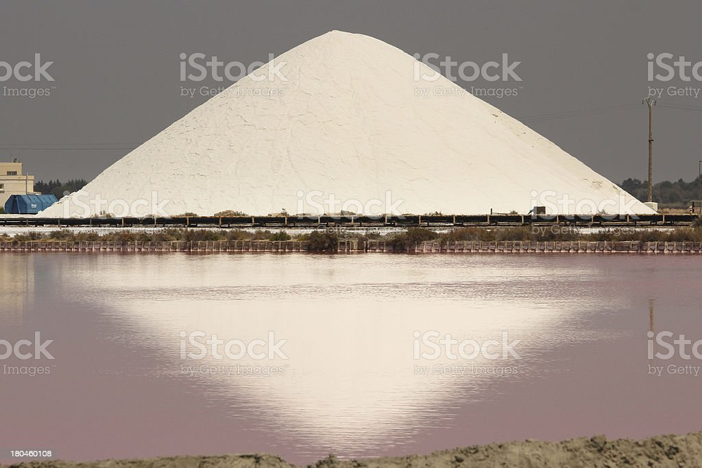 Mountain of salt and pink water royalty-free stock photo
