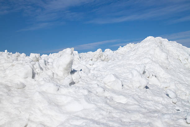 mountain of snow xl - snow pile stock photos and pictures