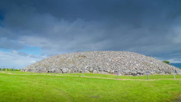 Mountain of stones in the Carrowmore Cemetery Ireland Mountain of stones in the Carrowmore Cemetery. Carrowmore County Sligo is one of the four major passage tomb complexes in Ireland. portal dolmen stock pictures, royalty-free photos & images