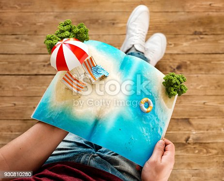 Tropical island with beach umbrella and deck chairs on a pages of opened magazine in hands. Unusual travel 3d illustration. Summer travel and vacation concept