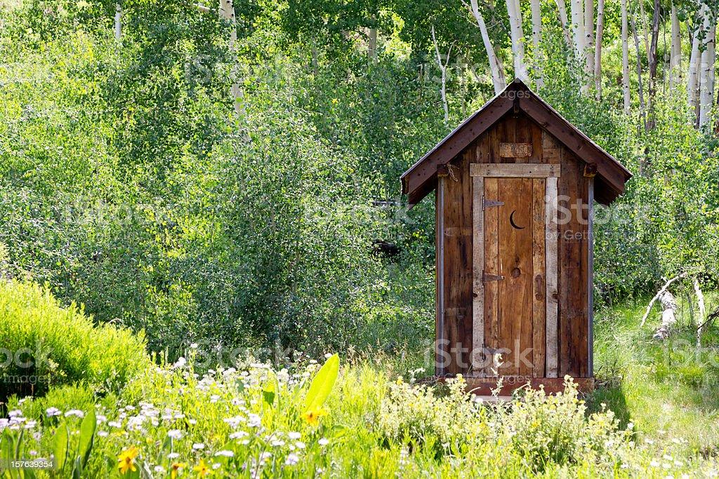 Mountain Outhouse stock photo