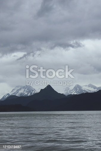 820775686 istock photo Mountain over water 1210419457