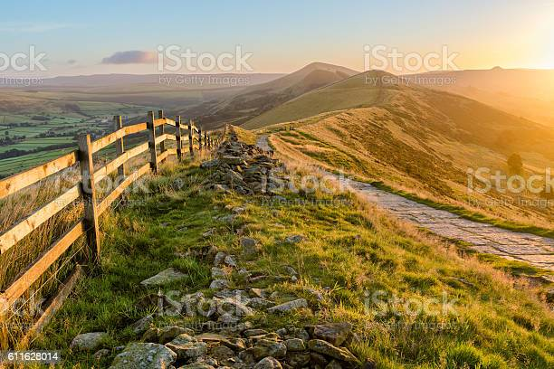 Photo of Mountain Path Bathed In Golden Sunlight.