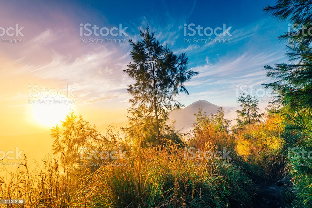 Mountain Path with Volcano scenery at sunrise, Bali stock photo