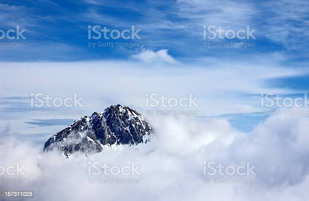 Photo of Mountain peak above the clouds