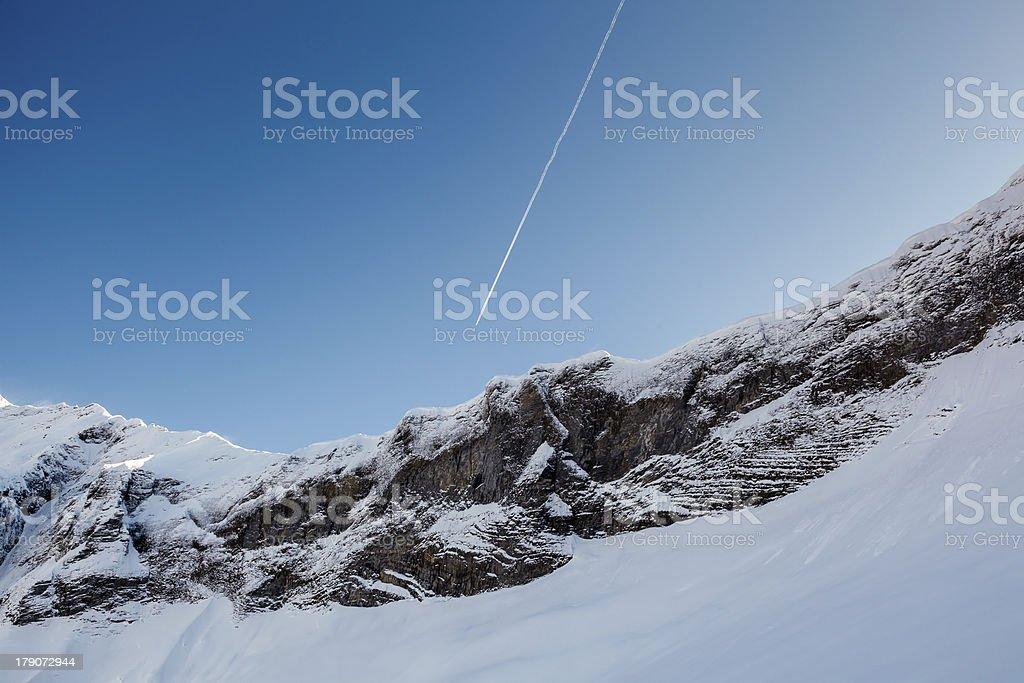 Mountain Peak and Airplane Trail near Megeve in French Alps royalty-free stock photo
