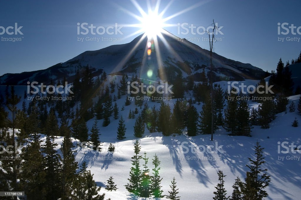 Mountain peak and sun. stock photo