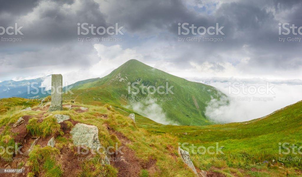 Mountain peak Hoverla in Carpathians in cloudy weather stock photo
