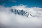 istock Mountain Peak In Clouds 1051186730