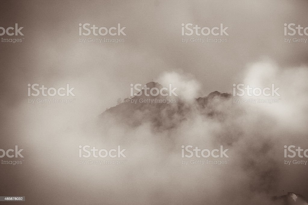Mountain peak in the clouds stock photo