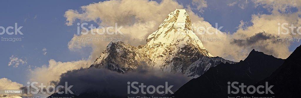 Mountain peak sunset panorama Ama Dablam Sagarmatha NP Himalaya Nepal stock photo