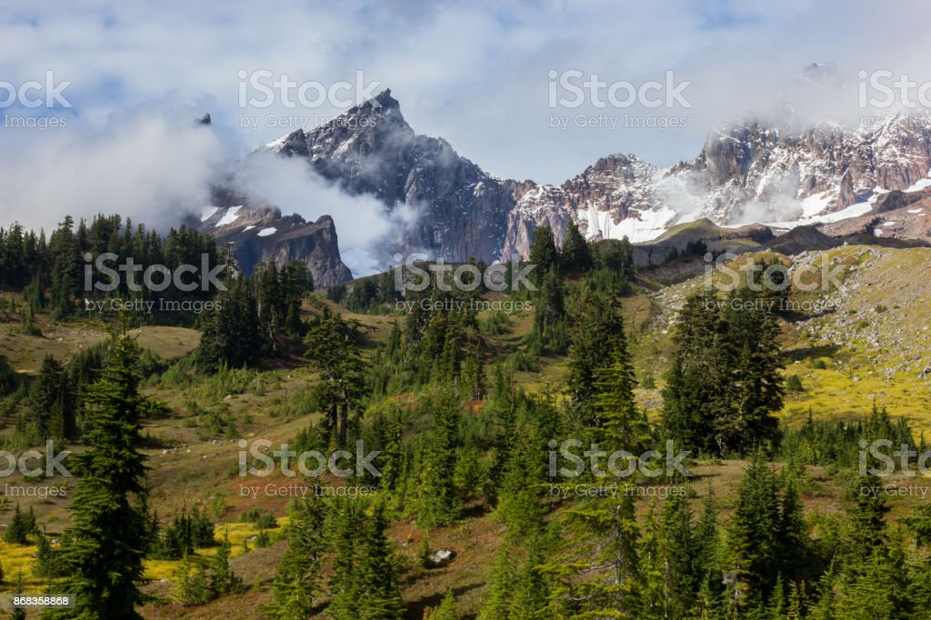 Mountain Peak Surrounded by Clouds stock photo
