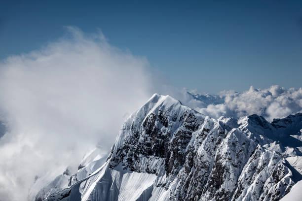 mountain peak, swiss alps, switzerland stock photo