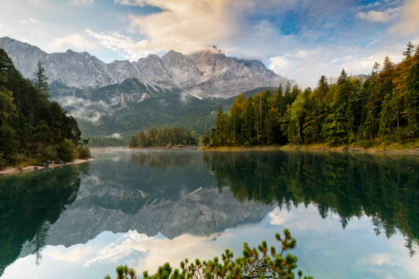 Mountain peak Zugspitze Autumn morning at lake Eibsee near Garmisch Partenkirchen. Bavaria, Germany stock photo