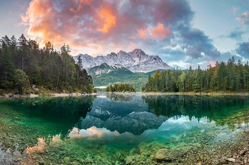 Mountain peak Zugspitze Summer day at lake Eibsee near Garmisch Partenkirchen. Bavaria, Germany