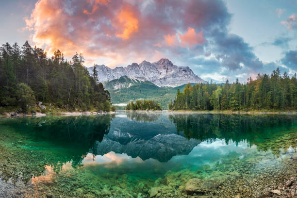 Mountain peak Zugspitze Summer day at lake Eibsee near Garmisch Partenkirchen. Bavaria, Germany stock photo