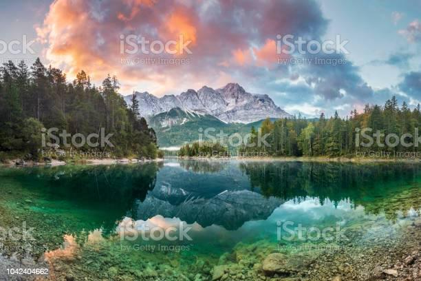 Photo of Mountain peak Zugspitze Summer day at lake Eibsee near Garmisch Partenkirchen. Bavaria, Germany