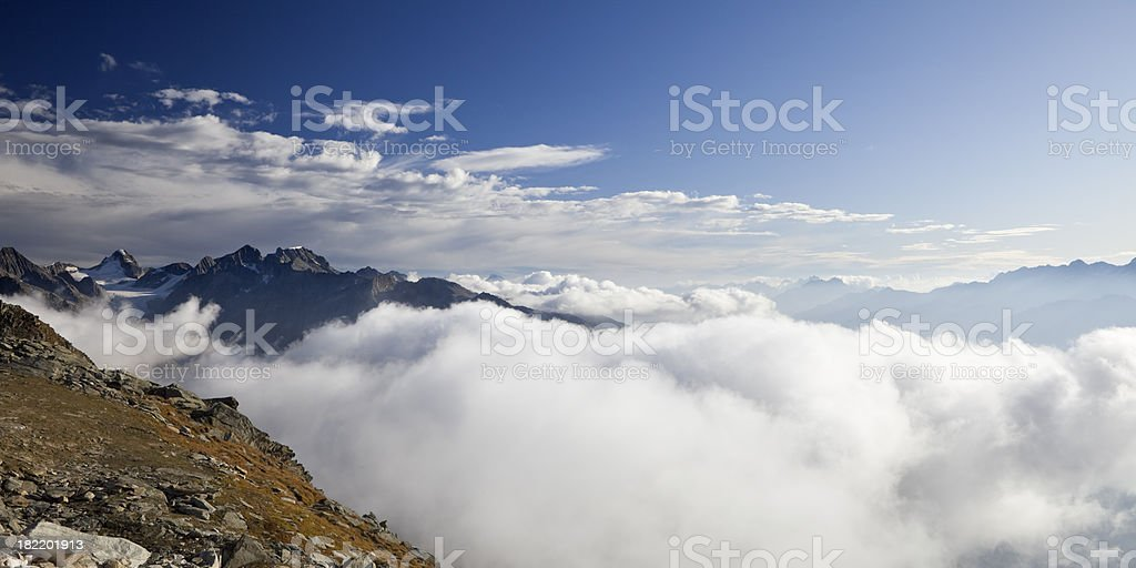 Mountain peaks and clouds in the European Alps in Switzerland royalty-free stock photo