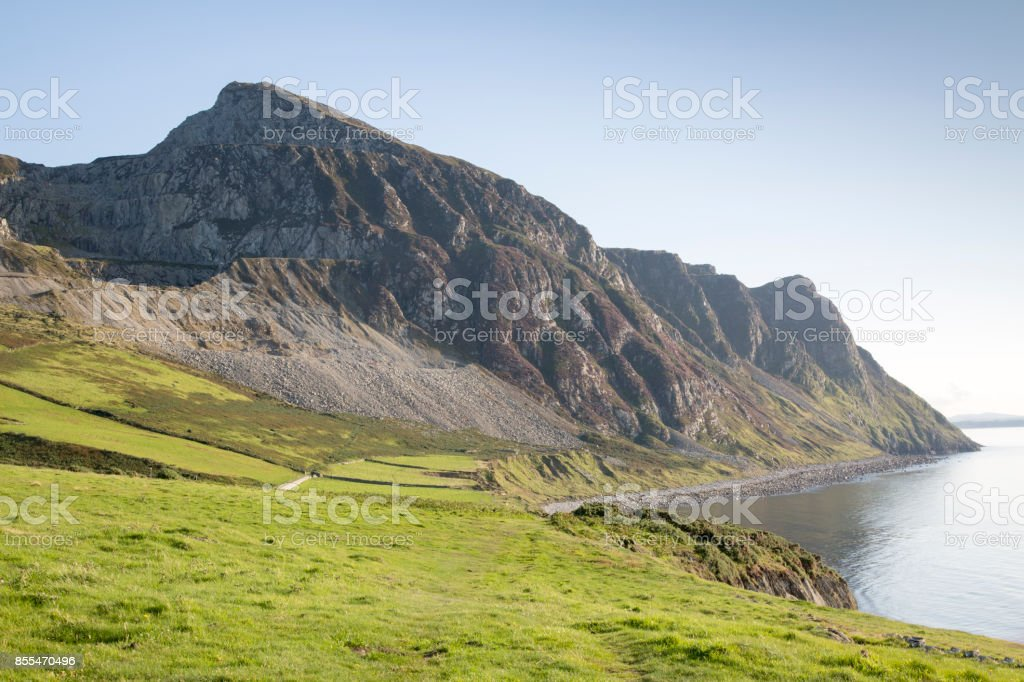 Mountain Peaks and Coastline, Trefor; Caernarfon; Wales stock photo