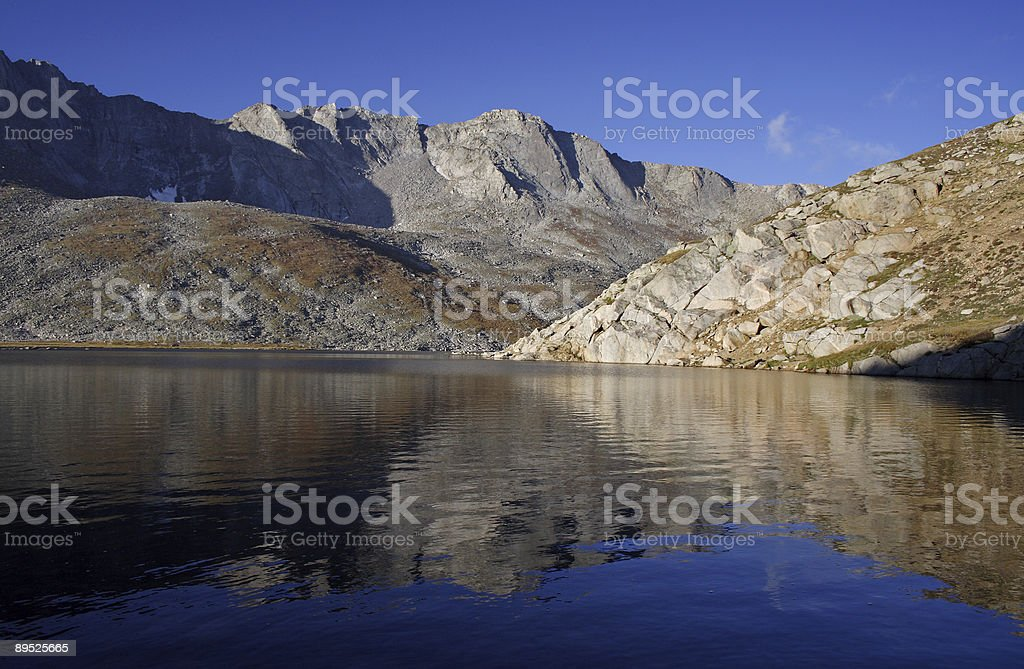 Mountain peaks and reflective lake royalty-free stock photo