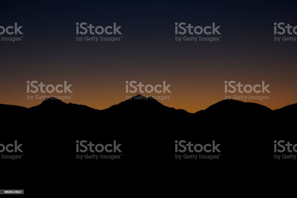 Mountain Peaks At Dawn Before Sunrise - Royalty-free Backgrounds Stock Photo