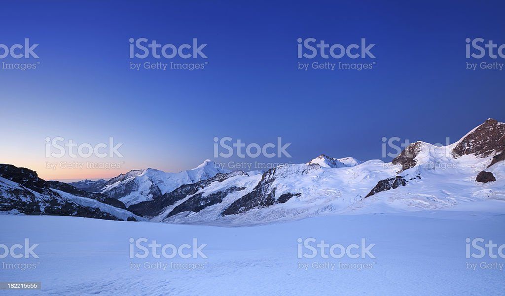 Mountain peaks at dawn from Jungfraujoch in Switzerland royalty-free stock photo