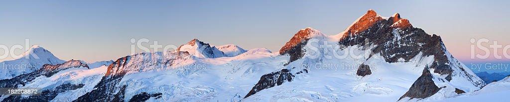 Mountain peaks at sunrise from Jungfraujoch in Switzerland stock photo