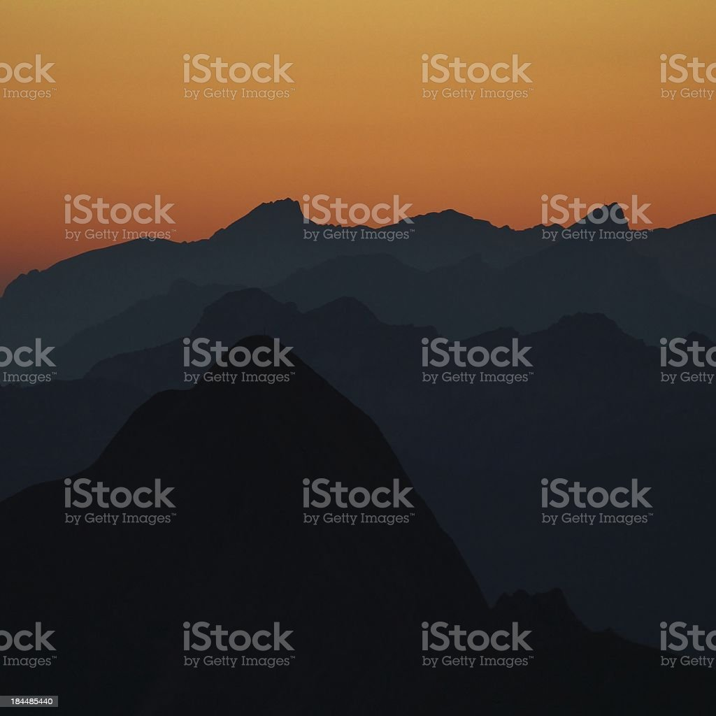 Mountain peaks at sunset royalty-free stock photo