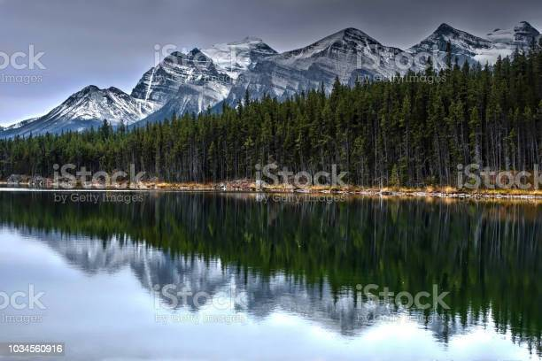 Mountain peaks covered with snow forest and reflections in calm lake picture id1034560916?b=1&k=6&m=1034560916&s=612x612&h=6adagsf 5 fcz5brb7sqw rsx7uygqq8nxp3nfba1y8=