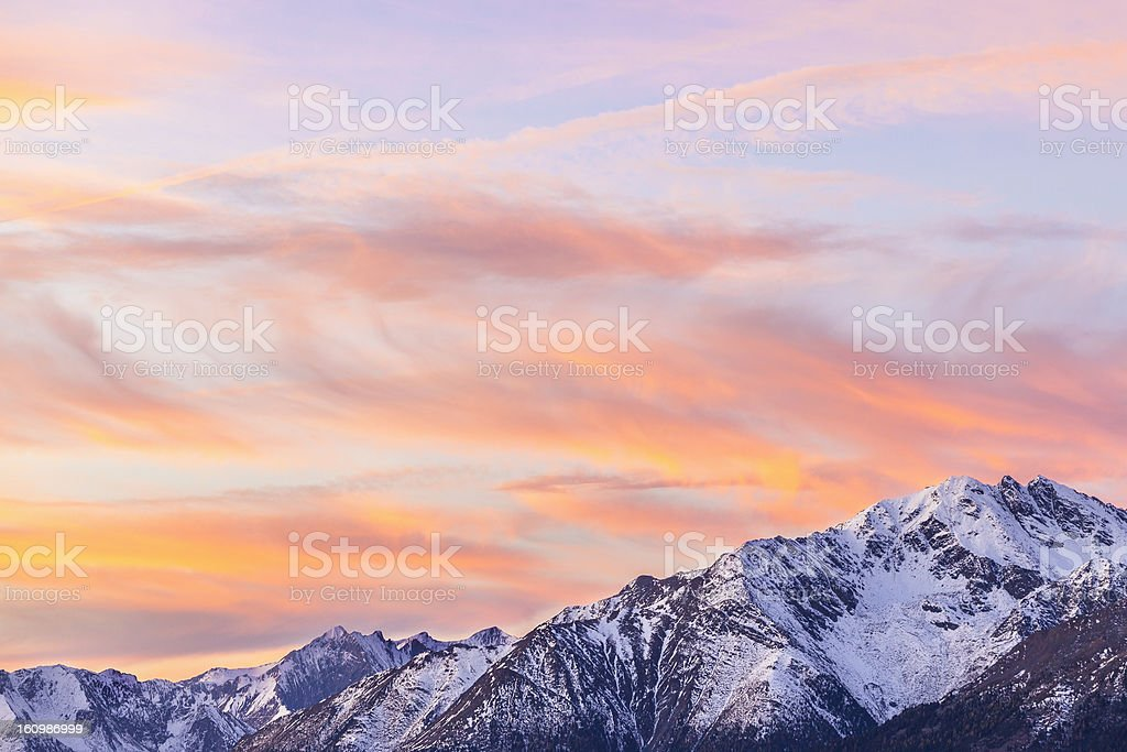 Mountain peaks in sunset royalty-free stock photo