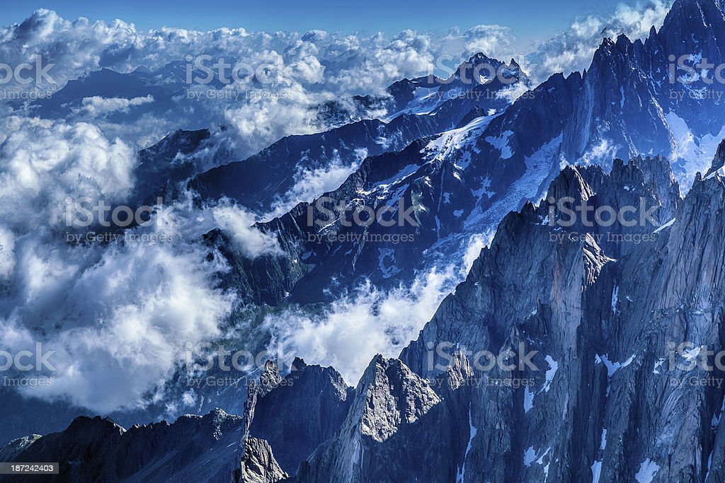 mountain peaks surrounded by clouds royalty-free stock photo