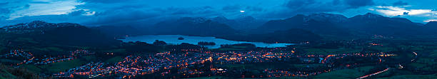 Mountain peaks town lights panorama Keswick Lake District Cumbria UK stock photo