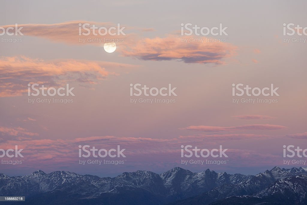 Mountain peaks with full moon royalty-free stock photo