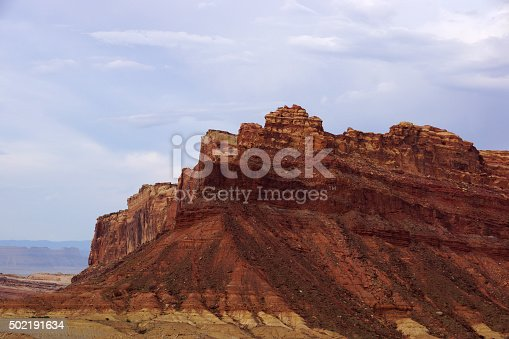 Mountain peek of Spotted Wolf Canyon with dramatic clouds in sky in Utah, USA.