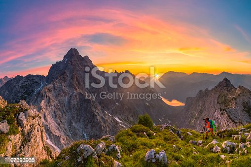 istock Mountain Photographer at glory sunrise with view to Watzmann and summit Cross of Mount Großer Hundstod 1167393938