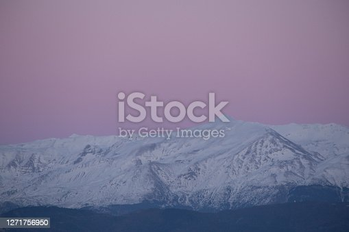mountain pick with snow and pink sky in spring season