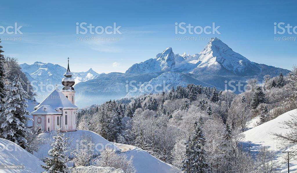 Mountain pilgrimage church in snowy Alpine scene stock photo