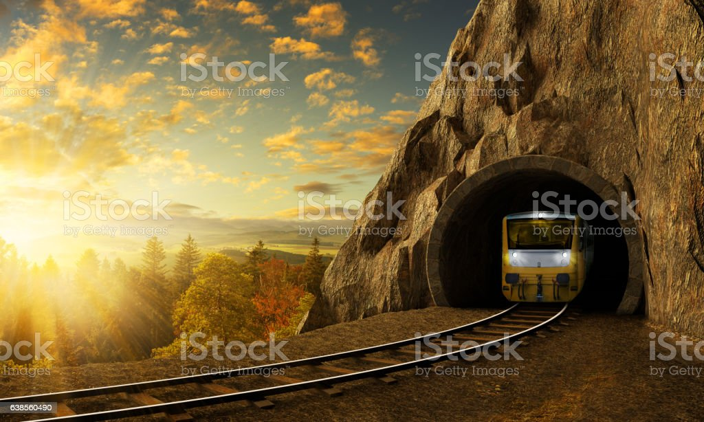 Mountain railroad with train in tunnel in rock above landscape. stock photo