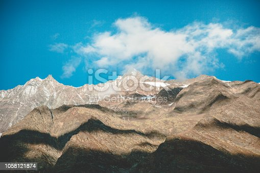 Scenic view of mountain range against blue sky in Saas Fee, Switzerland.
