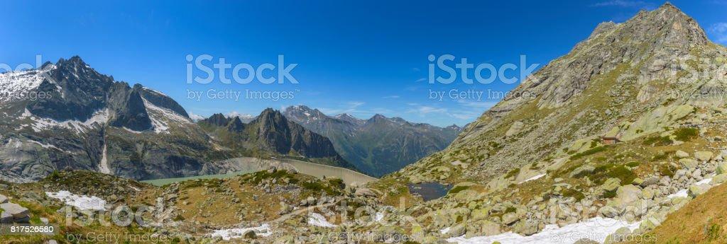Mountain range and Albigna dam, Switzerland stock photo