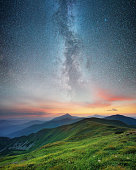 Mountain range and night sky. Natural summer landscape