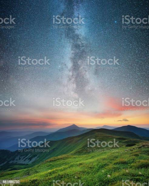 Photo of Mountain range and night sky. Natural summer landscape