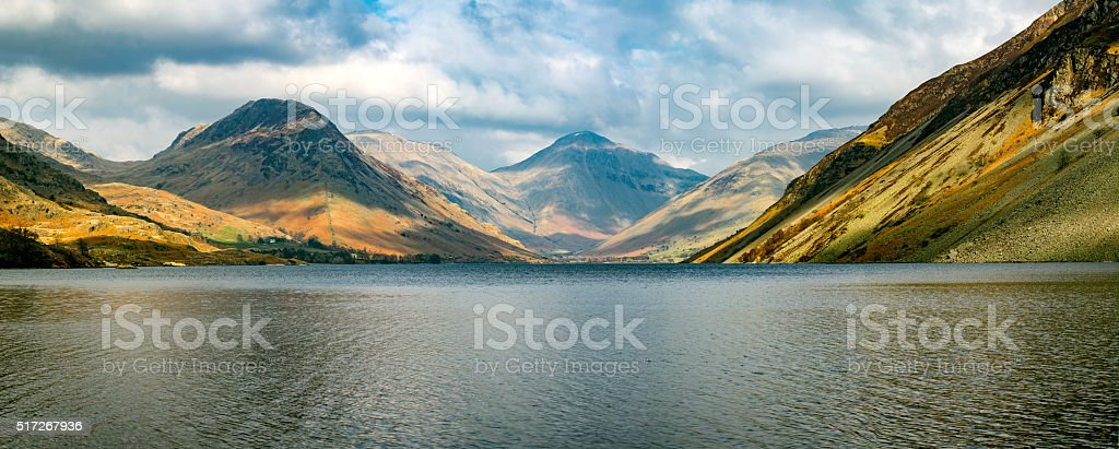 Mountain Range At Wastwater Lake With Dramatic Clouds. stock photo