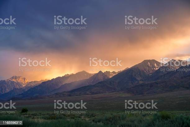 Mountain range colorful sunset with clouds before storm picture id1165596312?b=1&k=6&m=1165596312&s=612x612&h= 2wapk1z c4unndyuywwvuqhcxnblhxxl45pgc wqui=