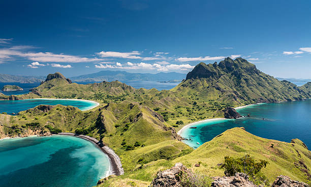 Mountain range in Komodo National Park in Indonesia Aerial view of the island 'Pulau Padar' at the famous Komodo National Park in Indonesia. Komodo is world wide famous for the beautiful underwater life, the diving sites and the Komodo dragon. Secluded white sand beaches also spot the islands of the archipelago. indonesia stock pictures, royalty-free photos & images