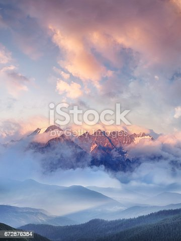 Mountain range in the clouds. Beautiful natural landscape