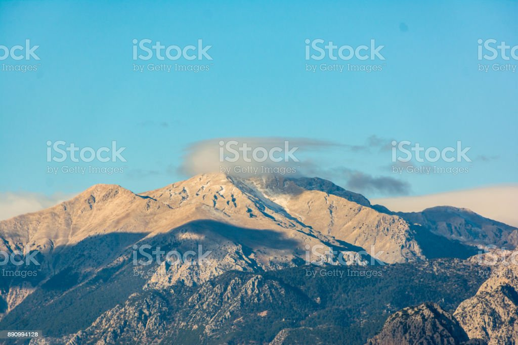 Mountain range in the clouds. Beautiful natural landscape stock photo