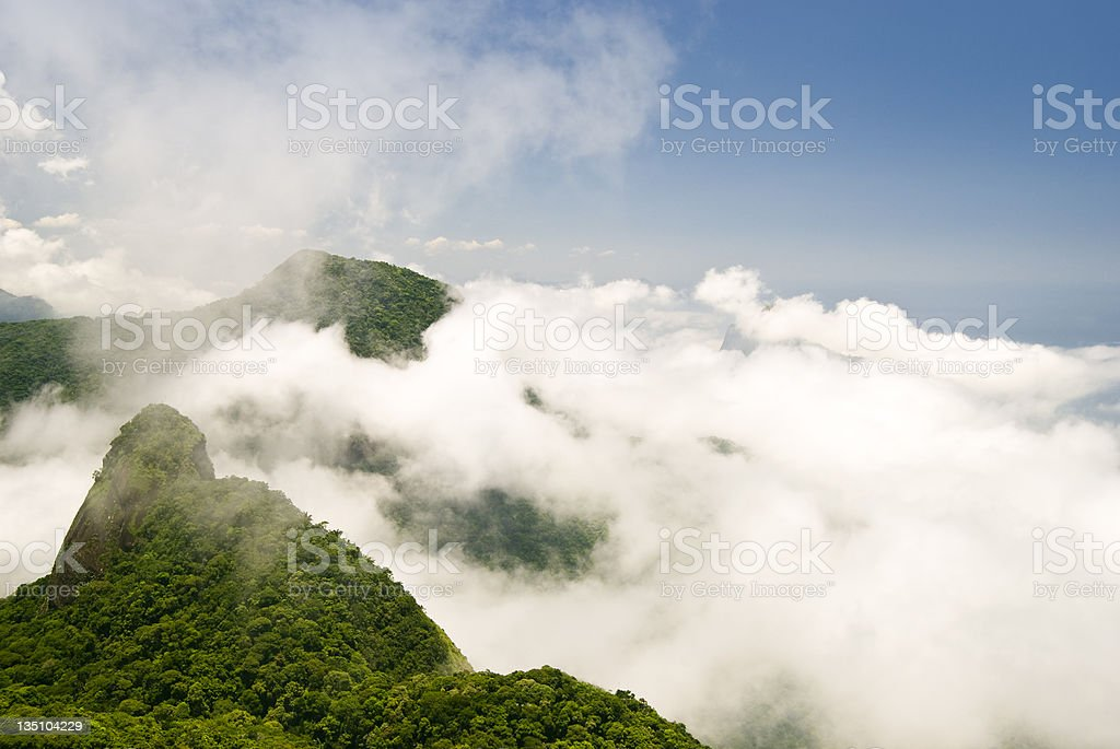 Mountain range over the clouds stock photo